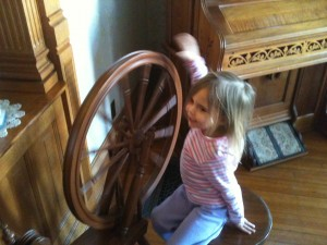 Eliana plays with the spinning wheel.